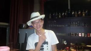 Yanghong in Mark's panama hat